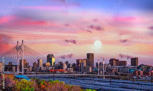 Johannesburg city skyline and Nelson Mandela bridge at sunset Wallpaper Mural