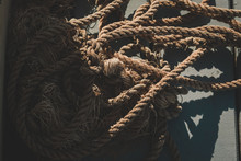 High Angle View Of Old Rope On Floor