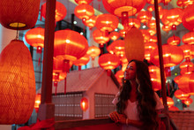 Happy Tourist Woman Enjoying Traditional Red Lanterns Decorated For Chinese New Year Chunjie. Cultural Asian Festival In Beijing.