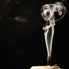 Close-Up Of Incense Burning Ag...