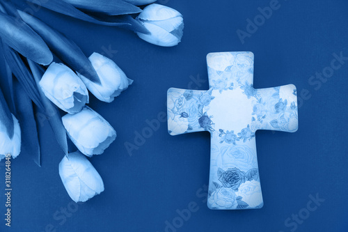 Photo Spring tulips and a ceramic cross in classic blue with space for text