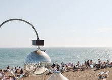 Reflection Of Brighton Beach On Disco Ball Against Clear Sky