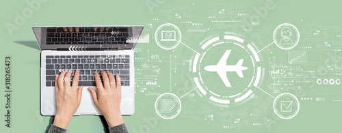 Photo Flight ticket booking concept with person using a laptop computer