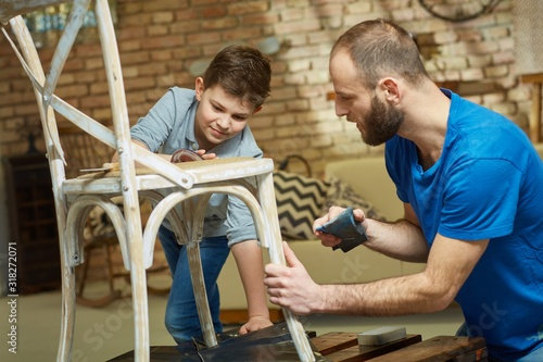 Obraz Father and son tinkering at home - fototapety do salonu