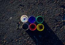 Directly Above Shot Of Color Bottles On Road