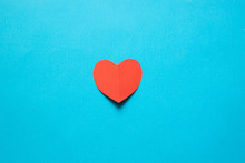 Red Heart Shaped Paper On Blue...