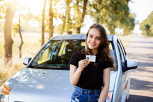 Proud Young Girl With Car Lice...