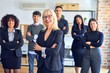 Group of business workers smiling happy and confident. Posing together with smile on face looking at the camera, middle age beautiful woman with crossed arms at the office
