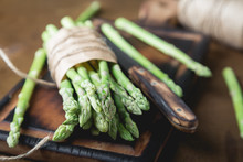 Fresh Asparagus On A Wooden Ta...