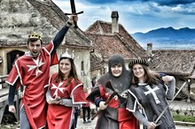Four People In Medieval Costumes