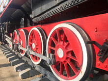 Large Iron Wheels Of A Red And...