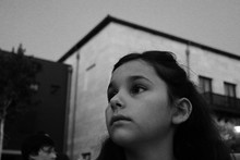 Thoughtful Girl Against Buildi...