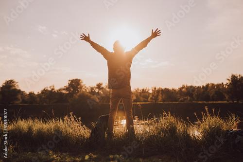 Carefree man enjoying nature and freedom Canvas Print