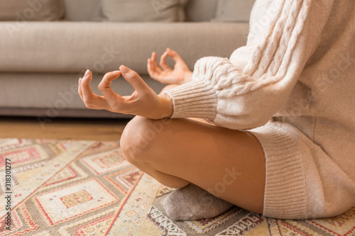Keep calm zen concept, woman sitting in lotus pose and meditating