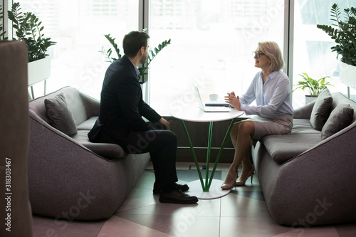Cuadros en Lienzo Smiling older hr manager holding job interview in office.