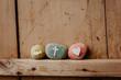 canvas print picture - Kommunion, Konfirmation, Firmung, Taufe - bunte Steine mit Kreuz, Fisch und Herz auf Holz