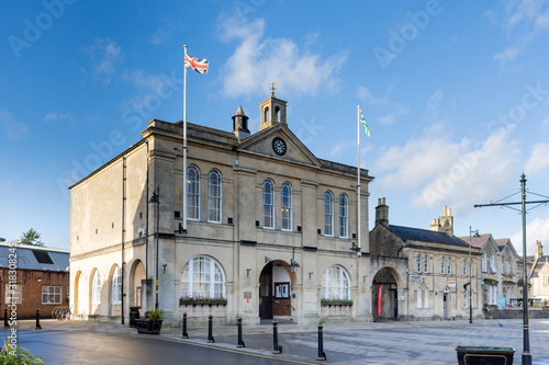 Melksham Town Hall against a blue winter sky with flags flying on a sunny winter Canvas Print