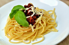 Detail Of Spaghetti Bolognese With Cheese And Basil. Italian Traditional Pasta Meal.