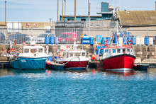 Row Of Colourful Fishing Boats...
