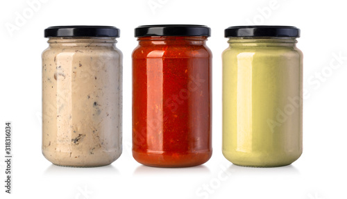 Fotografia sauce jars on white