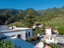 Old Traditional Houses At Village Las Nieves With Green Mountains And Subtropical Vegetation, Blue Sky Background. La Palma, Canary Islands.