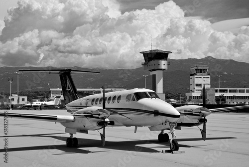 A private turboprop Beechcraft aircraft parked at Ajaccio airport on a black and Slika na platnu