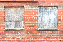 Red Brick Wall Boarded Up Windows