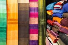 Multi Colored Fabrics Arranged In Shelf