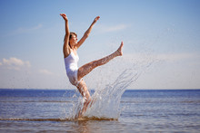 Woman Enjoys On Beach. Girl Ju...