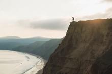 MAN STANDING ON SAND Precipice