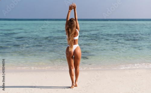 Sexy beautiful girl in white swimsuit on the islands in the ocean Canvas
