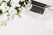 canvas print picture - Office desk workspace with laptop, flowers bouquet, clipboard on pink table. Flat lat, top view.