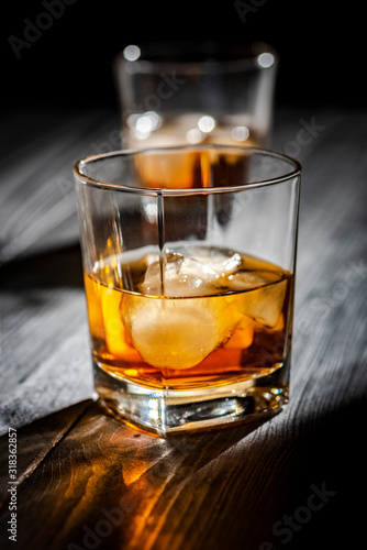 a glass of whiskey with ice Canvas Print