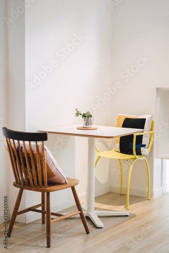 Canvas Table And Chairs On Hardwood Floor At Home