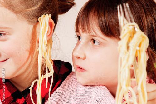 Fényképezés Noodles on the ears as symbol of deception and lies