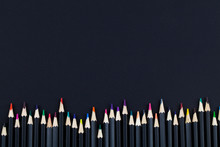 Line Of Colored Pencils On Bla...