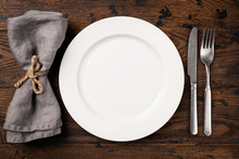 Table Setting With Empty White...