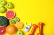 Leinwanddruck Bild - Fruits, vegetables, dumbbells and digital caliper on yellow background, flat lay with space for text. Visiting nutritionist