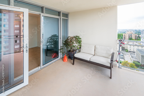 Fototapeta Empty balcony or veranda in a modern house or apartment.