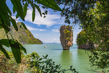 Thailand. Similan Islands. Islands In The Andaman Sea. James Bond Island On A Background Of Green Leaves. A Picturesque Rock Protrudes From The Water. Turquoise Waters Of The Andaman Sea.