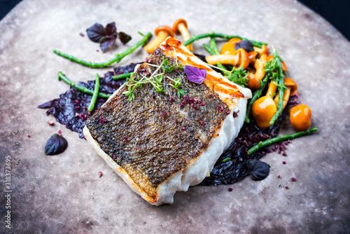 Tablou Canvas Gourmet fried European skrei cod fish filet with glasswort, fungi and algae as c