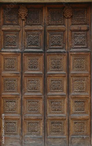 Obraz na plátně Elaborate carved wooden doors of Cathedral of St Catherine
