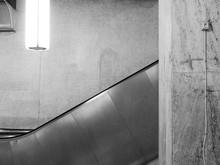 Escalator Against Wall At Subway Station