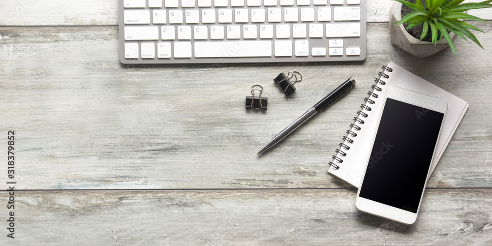Fototapeta White desk office with laptop, smartphone and other work supplies with cup of coffee. Top view with copy space for input the text. Designer workspace on desk table essential elements on flat lay