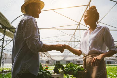 Obraz na plátně Handshake of business partners Vegetable farmer and customer investor dealing for business trading
