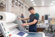 Printing Press Operator At Work