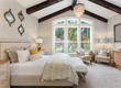 canvas print picture - Beautiful furnished master bedroom interior in luxury home . Features vaulted ceiling with wood beams and chandelier.