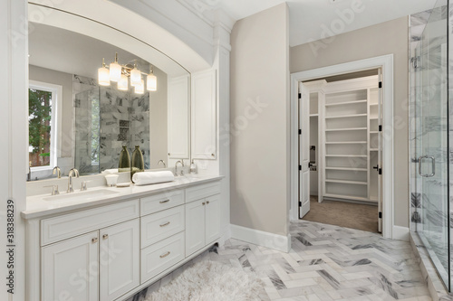 Fototapeta Master bathroom in new luxury home with double vanity and view of walk-in closet obraz