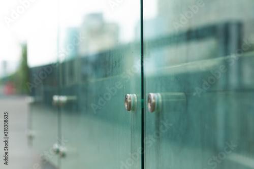 Fototapeta Soft focus, glass fence of a modern city of glass and concrete obraz