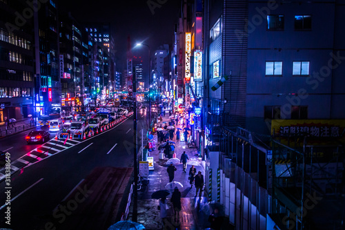Fototapeta High Angle View Of People Walking On Sidewalk In City At Night obraz na płótnie